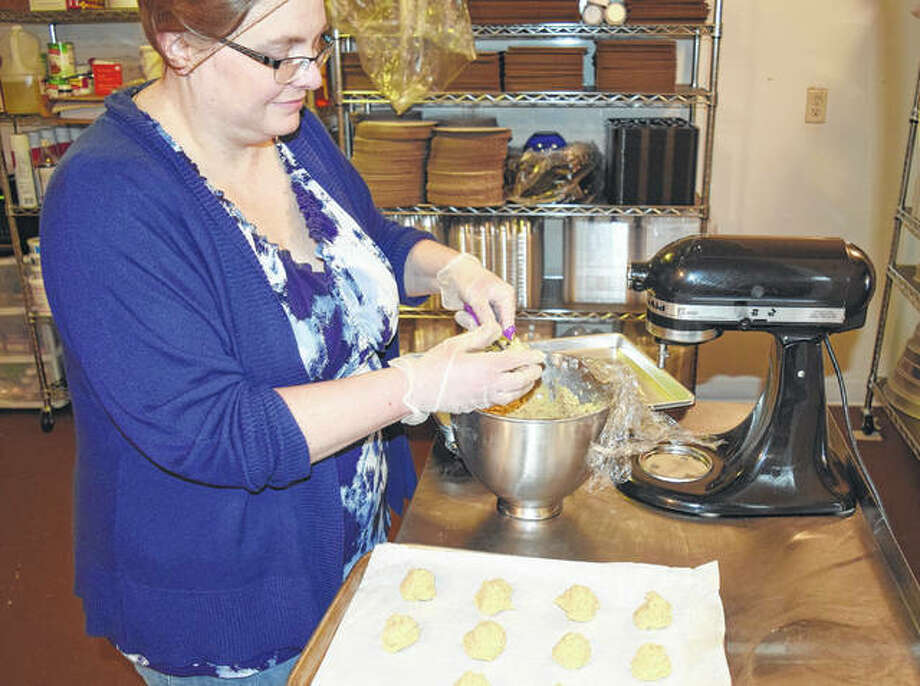 Michele Wallis of Waverly rolls out snickerdoodle dough at her new business, Annabelle's Bakery in Waverly. Photo: Greg Olson | Journal-Courier