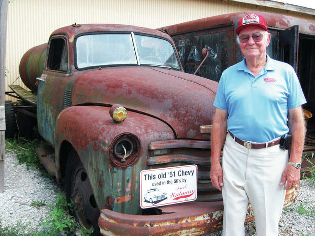 Widman Construction Inc.'s Fred E. Widman, 89, who died on Christmas Eve, is pictured with his beloved truck. He developed a passion for trucks at an early age. In the fall of 1952, Widman purchased his first truck, leading to the business that grew from this lifelong passion.