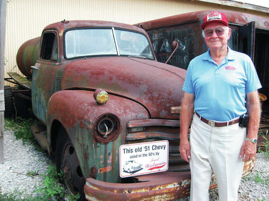 Widman Construction Inc.'s Fred E. Widman, 89, who died on Christmas Eve, is pictured with his beloved truck. He developed a passion for trucks at an early age. In the fall of 1952, Widman purchased his first truck, leading to the business that grew from this lifelong passion. Photo: For The Telegraph