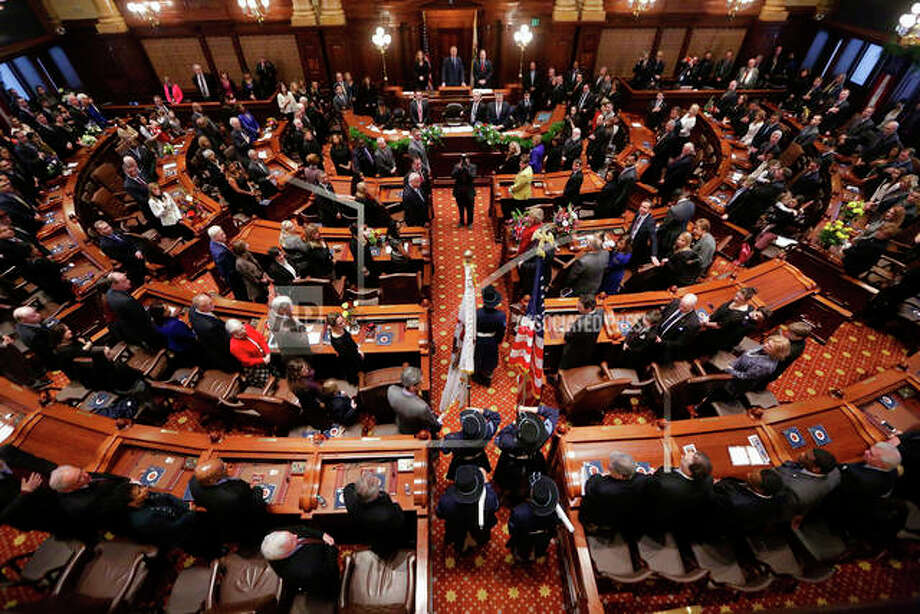 This Jan. 14, 2015 file photo shows the the Senate chamber at the State Capitol, in Springfield Ill. t was a big year in the Illinois statehouse with lawmakers ending an historic budget impasse and approving an income tax hike, overhauling how public schools get funding and allowing automatic voter registration. Now, a fresh set of 215 laws takes effect Jan. 1, 2018. The laws cover numerous topics, including the expansion of taxpayer-funded abortions, celebrating Barack Obama's presidency, allowing tax credits for private school scholarships, criminal justice reforms and a circus-related ban.