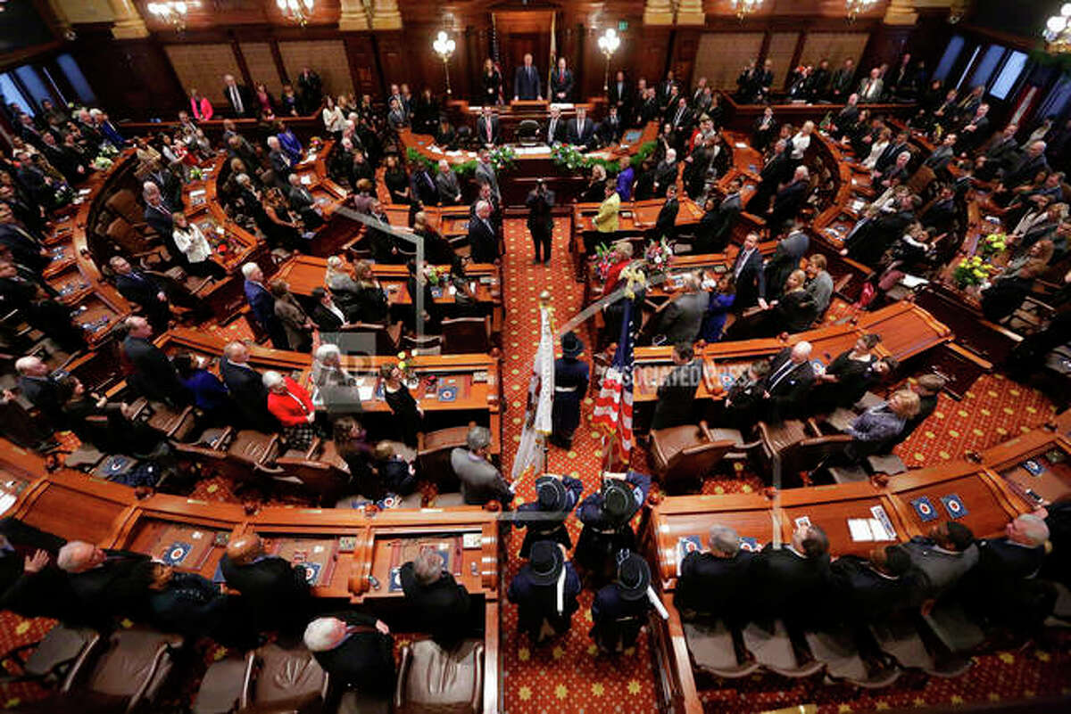 This Jan. 14, 2015 file photo shows the the Senate chamber at the State Capitol, in Springfield Ill. t was a big year in the Illinois statehouse with lawmakers ending an historic budget impasse and approving an income tax hike, overhauling how public schools get funding and allowing automatic voter registration. Now, a fresh set of 215 laws takes effect Jan. 1, 2018. The laws cover numerous topics, including the expansion of taxpayer-funded abortions, celebrating Barack Obama's presidency, allowing tax credits for private school scholarships, criminal justice reforms and a circus-related ban. (AP Photo/Seth Perlman File)