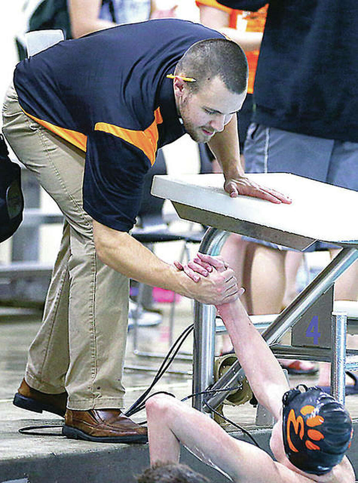 Edwardsville swim coach Christian Rhoten's Tigers will be entered in the Iron Invite meet this Saturday, which Rhoten called 'a great mid-season test.' Rhoten is shown during a meet last season.