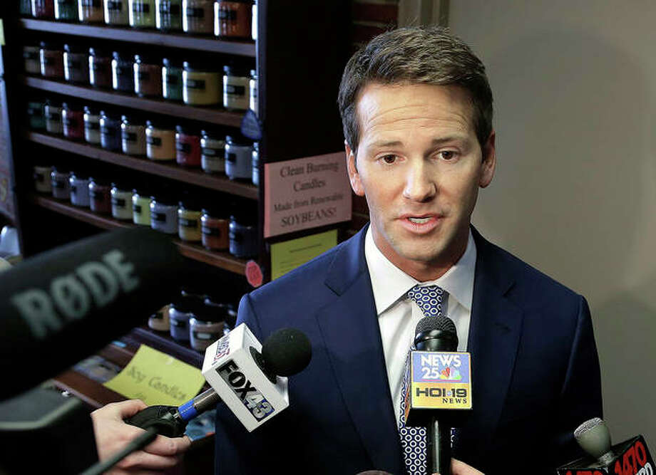 Seth Perlman | AP Former Rep. Aaron Schock speaks to reporters in Peoria in 2016. Attorneys for former Schock say a staffer secretly provided the government with a trove of confidential documents in violation of his right against unreasonable search and seizure. The lawyers write in court filings that the government went too far when it made the staffer an informant, requiring him to wear a wire to record conversations.