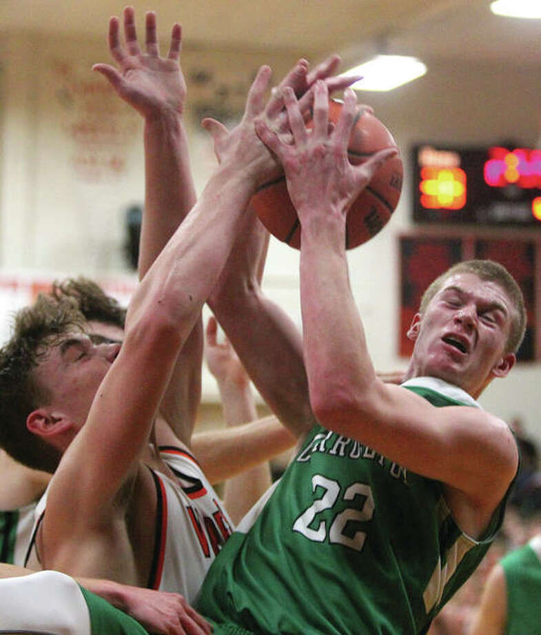 Carrollton's Gabe Jones (right) secures a rebound in the second half of the Hawks' victory over South County on Tuesday night in Franklin. Photo: Dennis Mathes   Journal-Courier