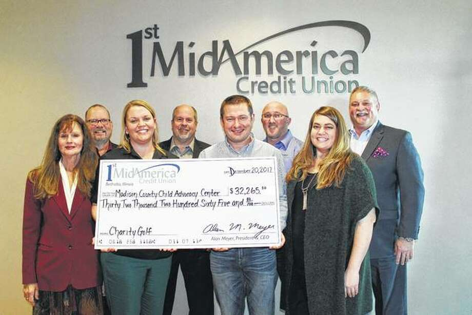 Pictured are, from back left, Perry Withers (1st MidAmerica Credit Union), Bob Blacklock (1st MidAmerica Credit Union), Jason Weiss (Child Advocacy Center) Alan Meyer (1st MidAmerica Credit Union President). Front from left: Patti Bortko (Child Advocacy Center Board Member), Carrie Cohan (Child Advocacy Center Executive Director), Travis Widman (Child Advocacy Center Board Member) and Claire Cooper (Child Advocacy Center). Photo: For The Telegraph