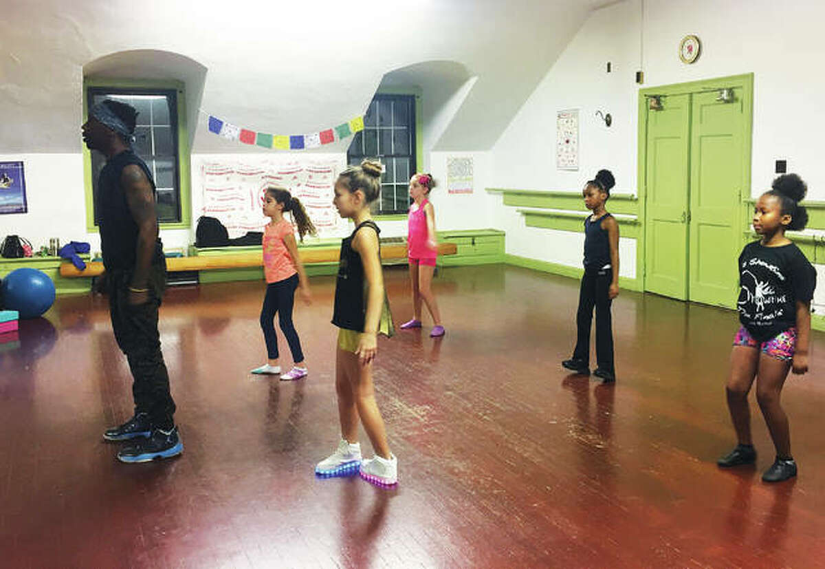 Dominique Williams leads a hip-hop class in M & M Showtime Productions' studio at the YWCA of Alton. Meghan McAfoos owns and teaches at M & M Showtime Productions, now located in the YWCA of Alton building on Third Street.