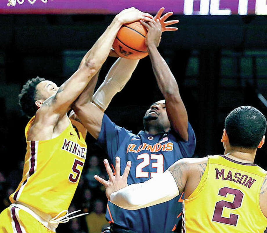 Minnesota's Amir Coffey, left, blocks a shot by Illinois' Aaron Jordan in Wednesday night's game in Minneapolis.