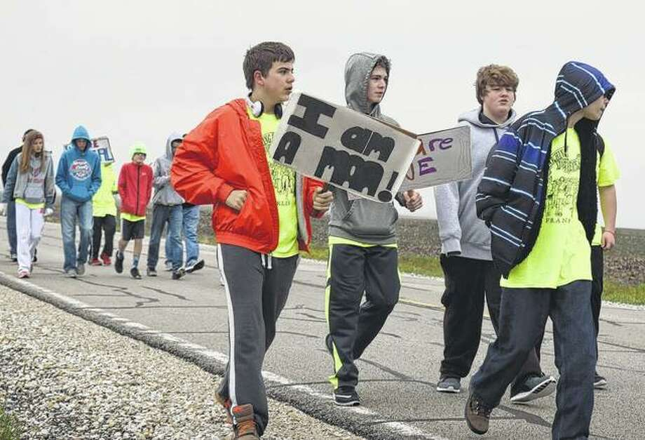 Seventh- and eighth-grade students from Franklin High School walk the seven-mile stretch between Alexander and Franklin Friday to show their support for equality and to raise money for a trip to Memphis. Photo: Samantha McDaniel-Ogletree | Journal-Courier