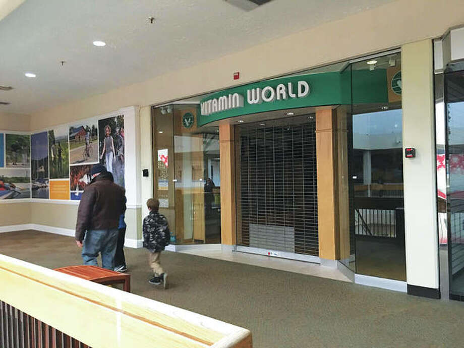 The former Vitamin World space sits empty, dark and shuttered at Alton Square Mall Wednesday. Photo: Jill Moon|The Telegraph