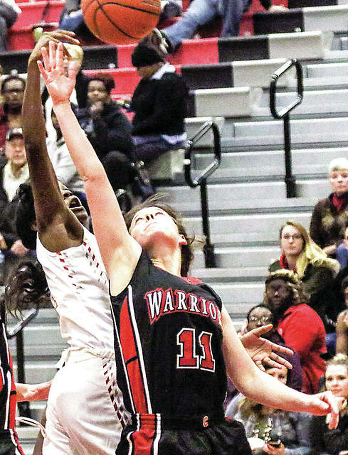 Emily McBride of Calhoun (11) led the Warriors with 14 points in 1 49-44 loss to Brown County Wednesday night in Mount Sterling. She is shown in action earlier this season.
