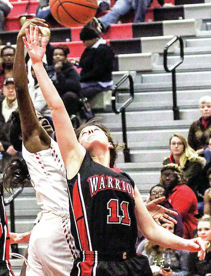 Emily McBride of Calhoun (11) led the Warriors with 14 points in 1 49-44 loss to Brown County Wednesday night in Mount Sterling. She is shown in action earlier this season. Photo: Telegraph File Photo