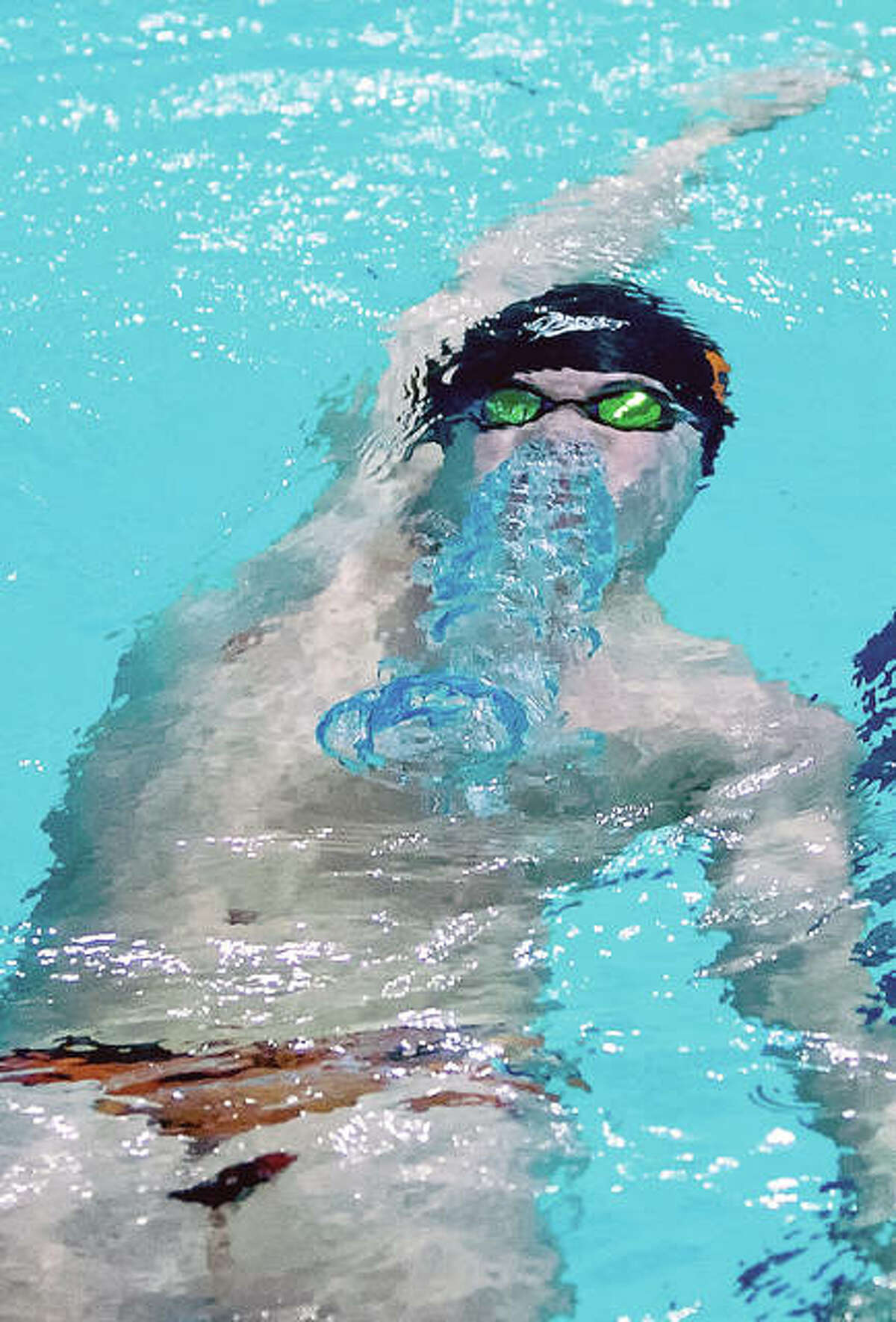 Edwardsville's Noah May comes up after the start of the 100-yard backstroke in dual meet action against Springfield Sacred Heart-Griffin Thursday night at the Chuck Fruit Aquatic Center. May won the event and the Tigers rolled to a 139-38 victory.