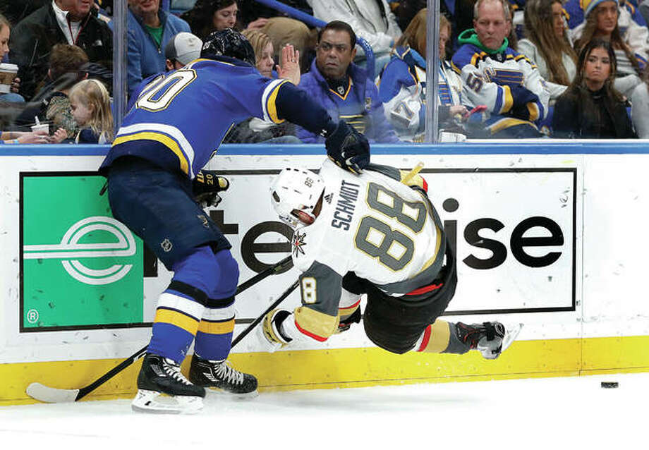 Nate Schmidt of the Vegas Golden Knights (88) falls against the boards while chasing a loose puck with the Blues' Alexander Steen, left Thursday in St. Louis. Photo: AP