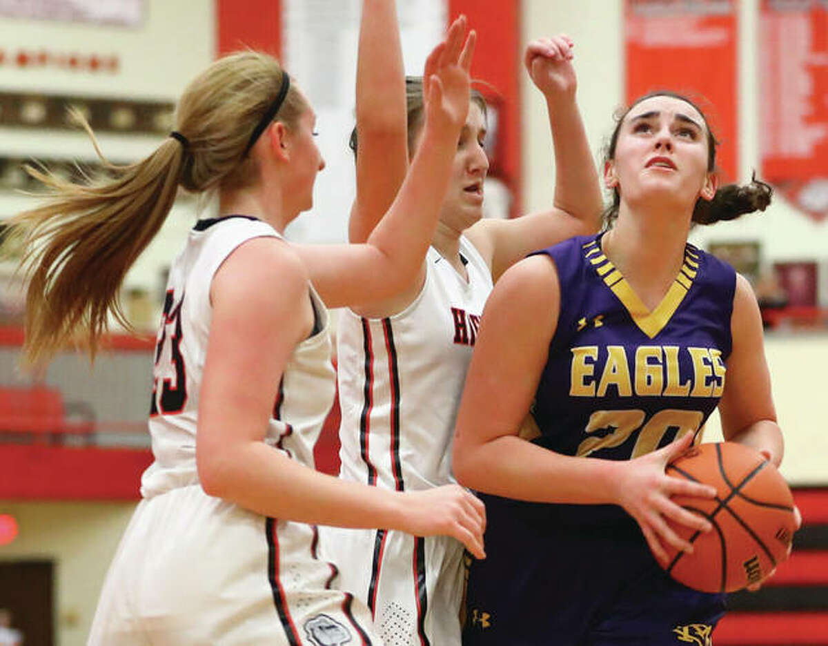 CM's Anna Hall (right) scored 13 points and pulled down seven rebounds in her team's 58-5 win over Mascoutah Thursday. She is shown in earlier action against Highland.