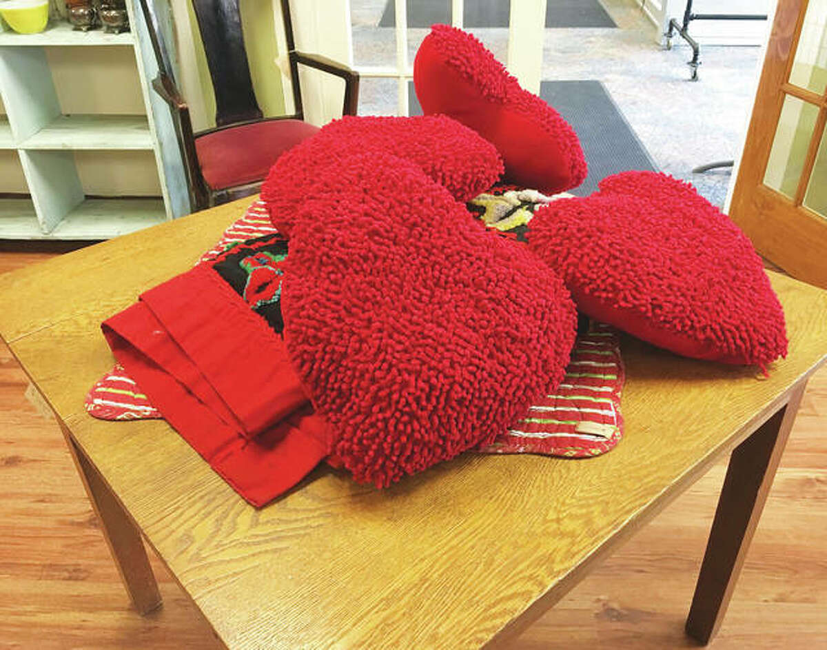 """Wood River's Country Meadows carries more """"gifty things,"""" such as plush heart-shaped pillows, in time for Valentine's Day."""