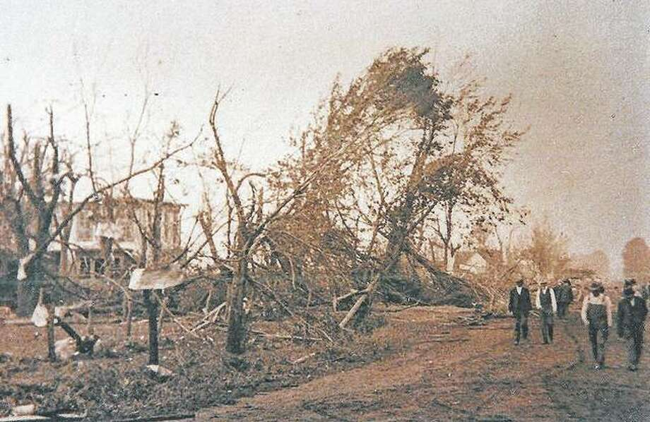 Modesto residents wander along Main Street in 1917, surveying the damage resulting from a tornado. Photo: Photo Provided