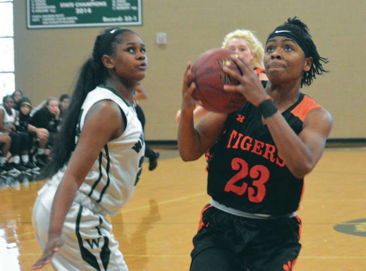 Edwardsville's Myriah Haywood-Noodel (23) goes up for a shot after beating a Whitfield defender in the lane during a Tigers' shootout victory Saturday in St. Louis.