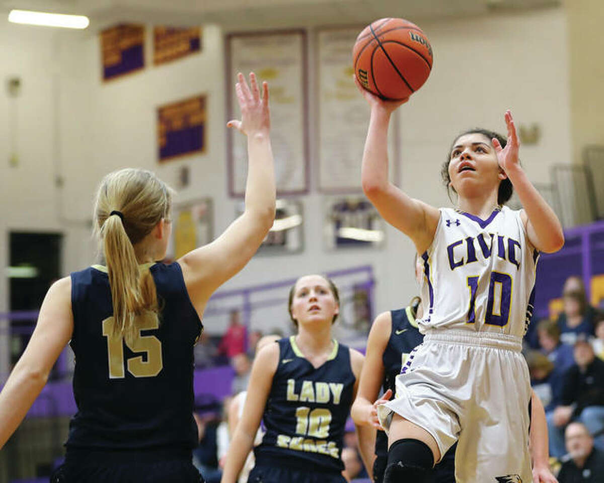 CM's Kourtland Tyus (right) puts up a shot in the lane over Teutopolis' Olivia Niemerg during the Eagles' 55-42 victory Monday night in Bethalto.