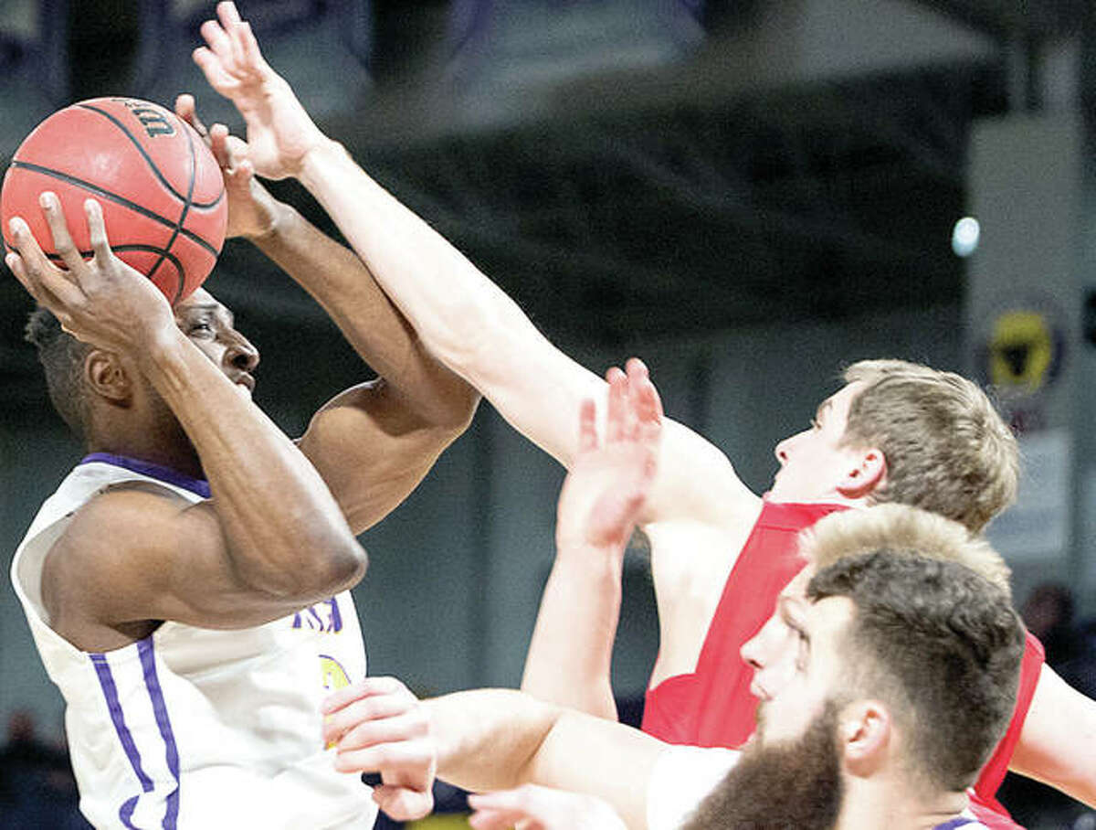Minnesota State guard Carlos Anderson (left) jumps for a shot as MSU Moorhead's Britn Bussman applies pressure during a Minnesota State victory Dec. 30 at Bresnan Arena in Mankato, Minn. Anderson, an Alton High grad and transfer frm SIUE, scored 12 points in the game.