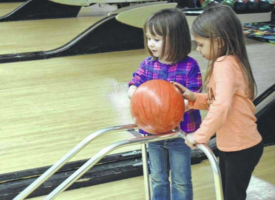 Adalyn Heinemann (left), 5, daughter of Chelsea Heinemann, and Brooke Zuhone, 4, daughter of Nick and Rebecca Zuhone, bowl during the Bowl for Kids Sake event Friday night at the Bowl Inn. The event will continue today from 1-9 p.m. Photo: Samantha McDaniel-Ogletree | Journal-Courier