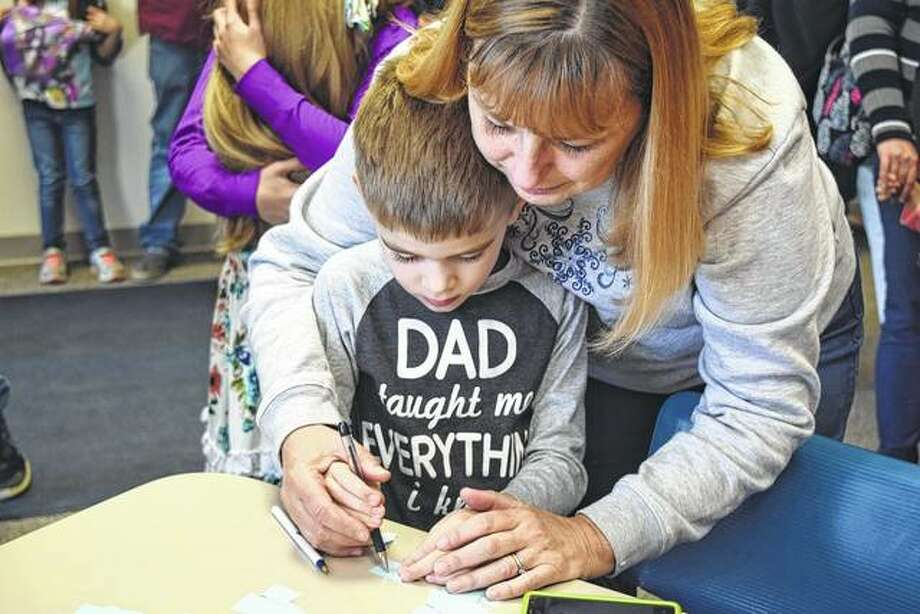 Owen Haverfield, 5, gets help with voting for his favorite piece of artwork at Lincoln Land Community College during the annual Community Art Show from his grandmother, Debbie Kays. Photo: Samantha McDaniel-Ogletree | Journal-Courier