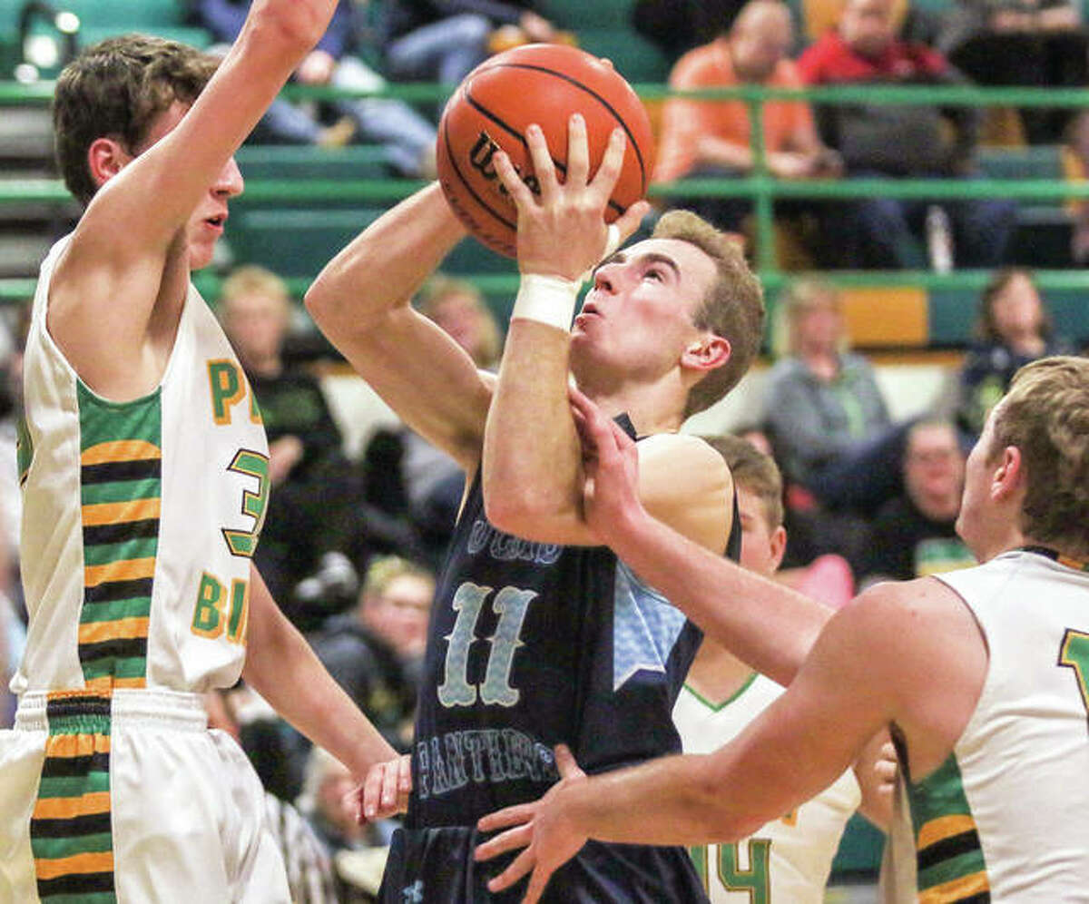 Jersey's Brett Tuttle drive to the basket against Southwestern's E.J. Kahl in Tuesday's 75-45 Panthers victory at Piasa.