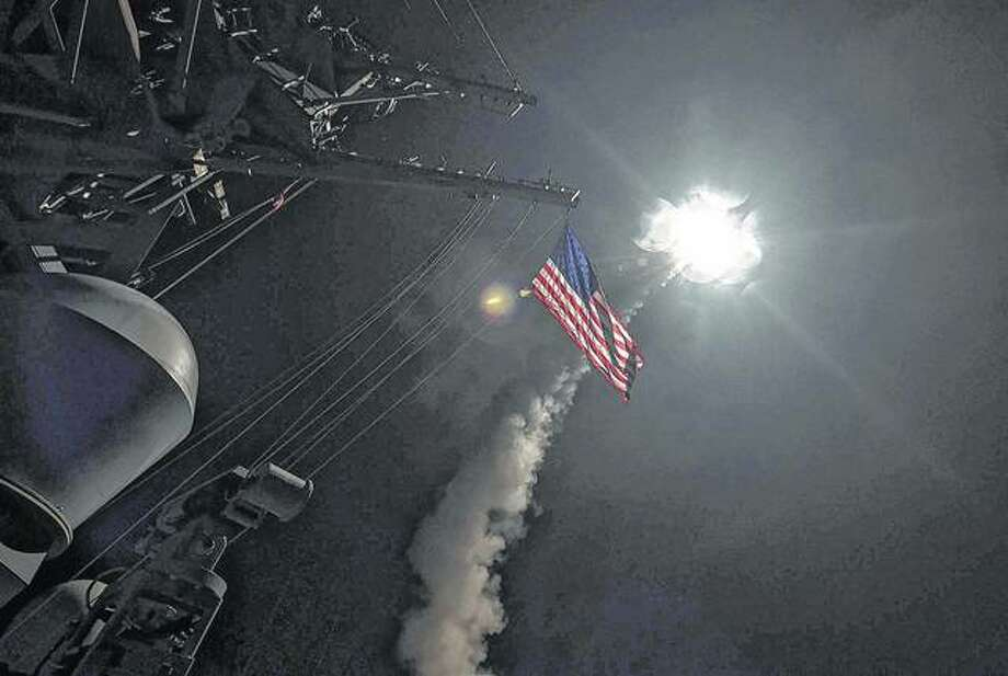 Ford Williams | U.S. Navy The guided-missile destroyer USS Porter launches a tomahawk land attack missile in the Mediterranean Sea. The United States blasted a Syrian air base with a barrage of cruise missiles in retaliation for this week's chemical weapons attack against civilians.