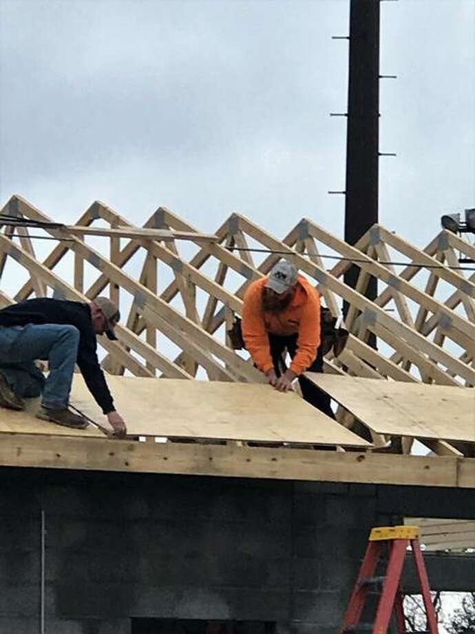 Volunteers from Jun Construction of Godfrey took advantage of Wednesday's warmer temperatures and installed roof trusses and sheeting on the evolving concession stand at Gordon F. Moore Community Park in Alton. Photo: Photos By Bob Barnhart | For The Telegraph