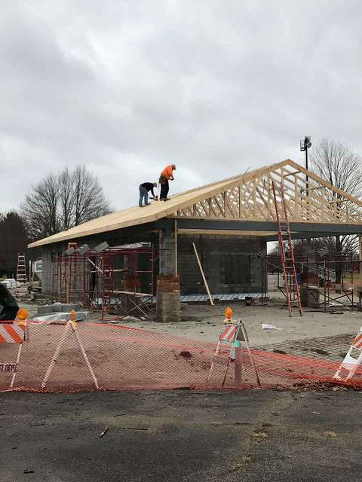Volunteers work to construct a new concession stand at Gordon F. Moore Community Park in Alton Wednesday, as one part of $2.2 million in planned - and some completed - upgrades at the park.