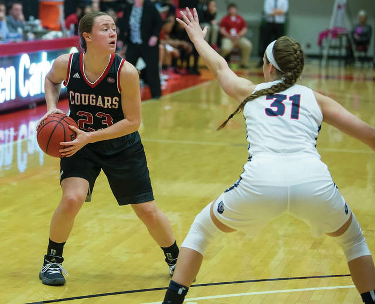 SIUE freshman Allie Troeckler (left) looks for a teammate while Belmont's Maura Muensterman defends during an OVC women's basketball game Wednesday night at Vadalabene Center in Edwardsville.
