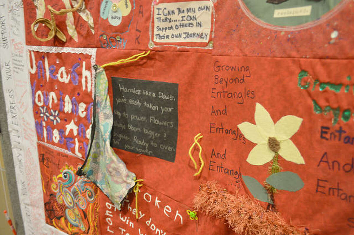 """The Monument Quilt, decorated by survivors of rape and abuse with phrases like, """"Unleash your inner wings and fly,"""" hangs in the lobby of Alton's Centerstone counseling and mental health office, 2615 Edwards St. The quilt is aimed to help survivors reconnect to their communities - and to allow communities to publicly support survivors and learn about how abuse impacts their citizens."""