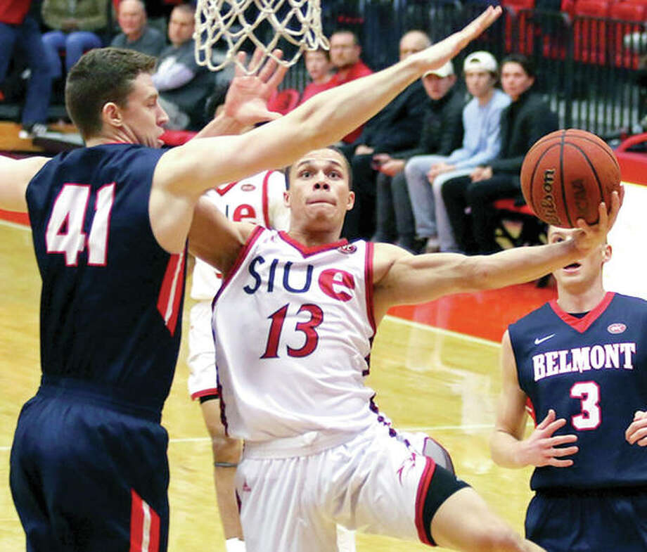 SIUE's Christian Ellis (13) drives against Tyler Hadden of Belmont in Thursday night's game at the Vadalabene Center. Ellis scored seven points, but SIUE lost 76-61. Photo: SIUE Athletics