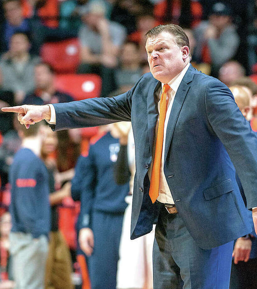 Illinois coach Brad Underwood motions to his players during Thursday night's game against Iowa in Champaign. Photo: AP