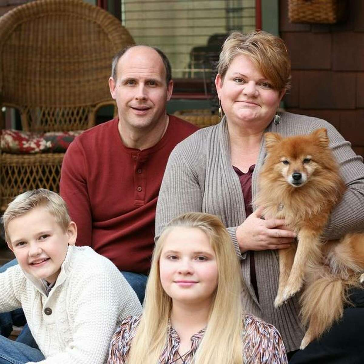 Brian Hanson with his wife, Amy, son Ben and daughter Haley, plus their dog Chewie.