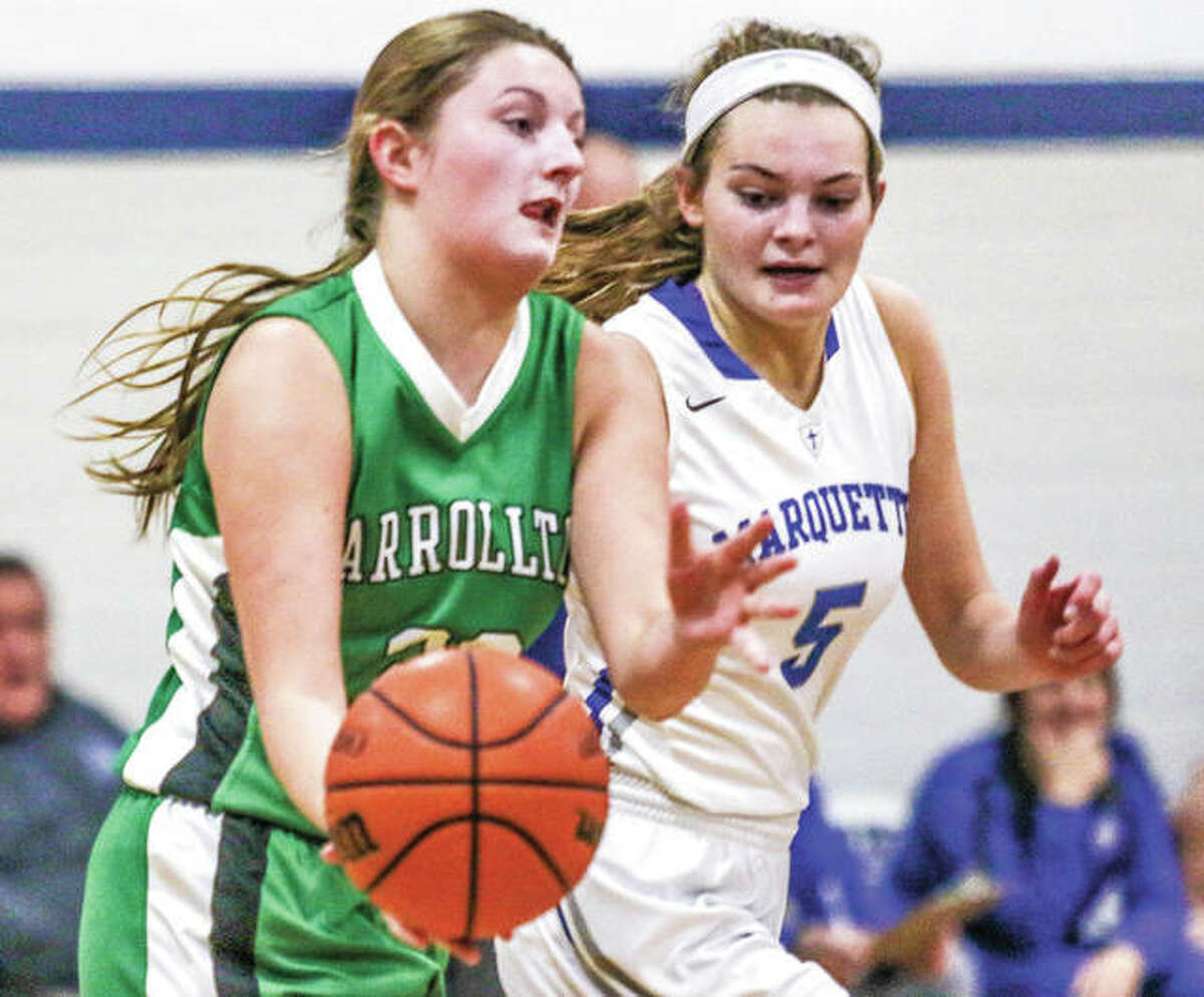 Carrollton's Kaylie Rhoades (left) pushes the basketball upcourt while under pressure from Marquette Catholic's Lila Snider during a game Jan. 3 in Alton. Both the Hawks and Explorers were home for games Friday night, with Carrollton losing to Calhoun and Marquette beating Lift For Life.