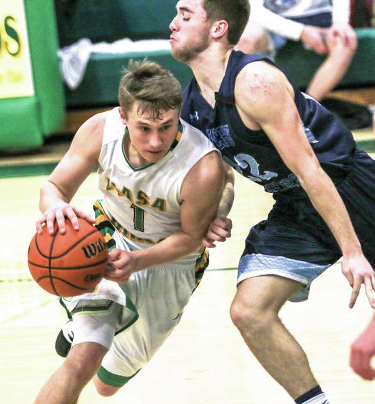 Southwestern's Justin Bailey (left), shown driving on Jersey's Nathan Goldacker on Tuesday in Piasa, and the Birds were back at home Friday for a home South Central Conference game with Greenville. The Comets won 48-45.