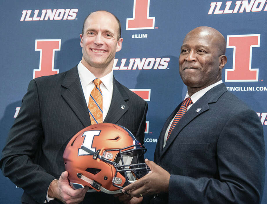 Illinois AD Josh Whitman (left) and Illini football coach Lovie Smith at the press conference naming Smith as the coach in 2016. Photo: AP File