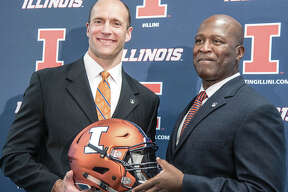 Illinois AD Josh Whitman (left) and Illini football coach Lovie Smith at the press conference naming Smith as the coach in 2016.