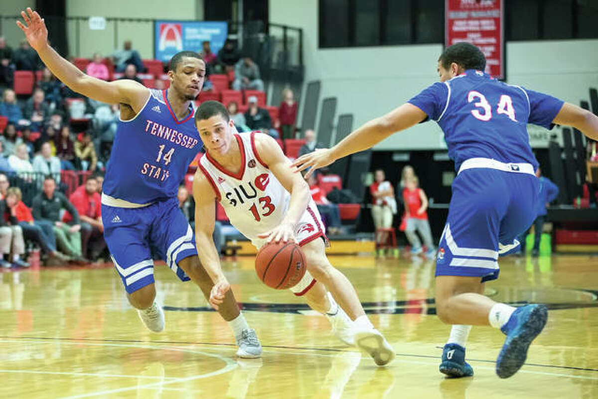 SIUE's Christian Ellis (middle) splits Tennessee State defenders Darreon Reddick (left) and Jalen Duke during the Cougar's Ohio Valley Conference victory Saturday night at Vadalabene Center in Edwardsville.