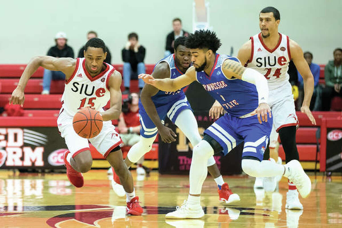 SIUE's David McFarland (left) pushes the ball upcourt ahead of Tennessee State's Delano Spencer on Saturday night at Vadalabene Center in Edwardsville.