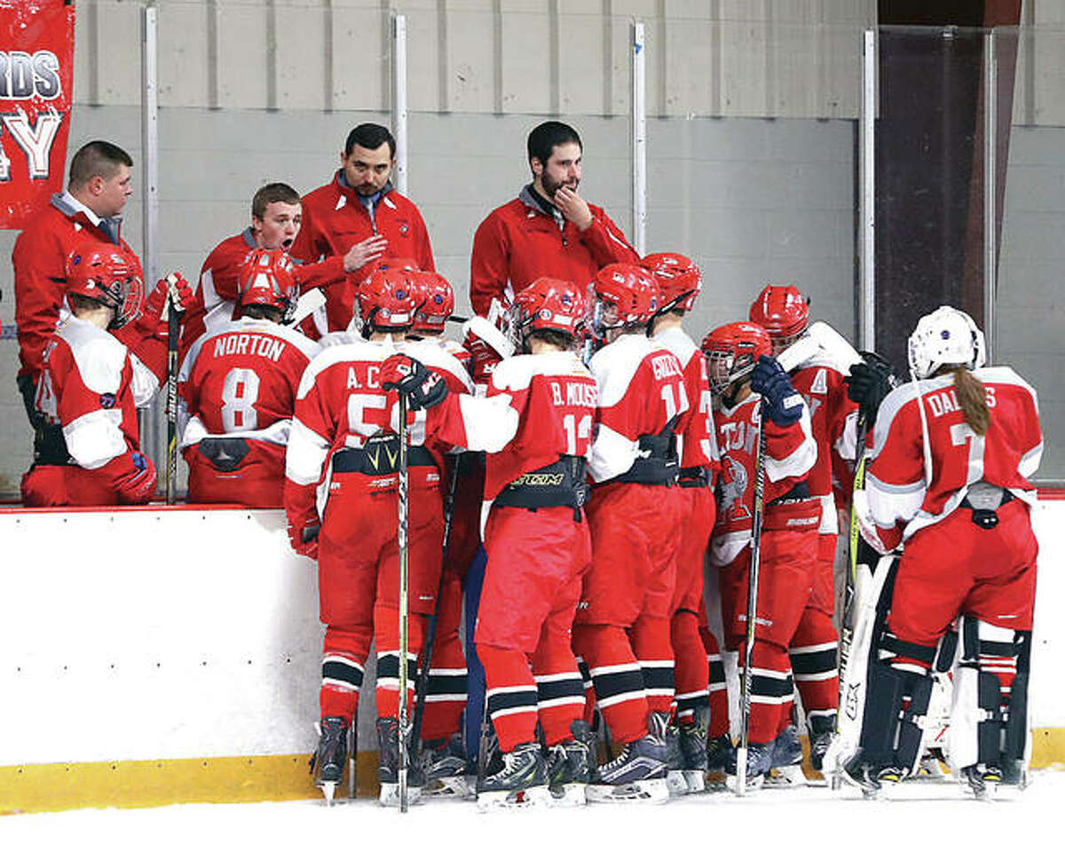 The Alton Redbirds dropped a 4-1 decision to Triad Monday night at the East Alton Ice Arena. Above, the Alton coached give instructions during a recent game.