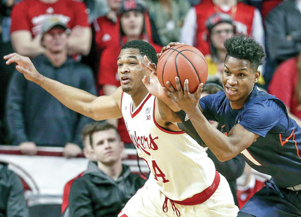 Trent Frazier of Illinois (1) and Nebraska's James Palmer Jr. go for a rebound during Monday night's game in Lincoln, Neb.