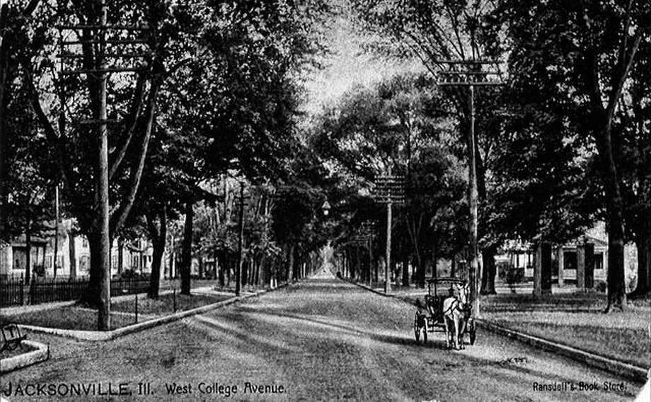 West College Avenue is lined with towering elm trees in this photo from the early 1900s.