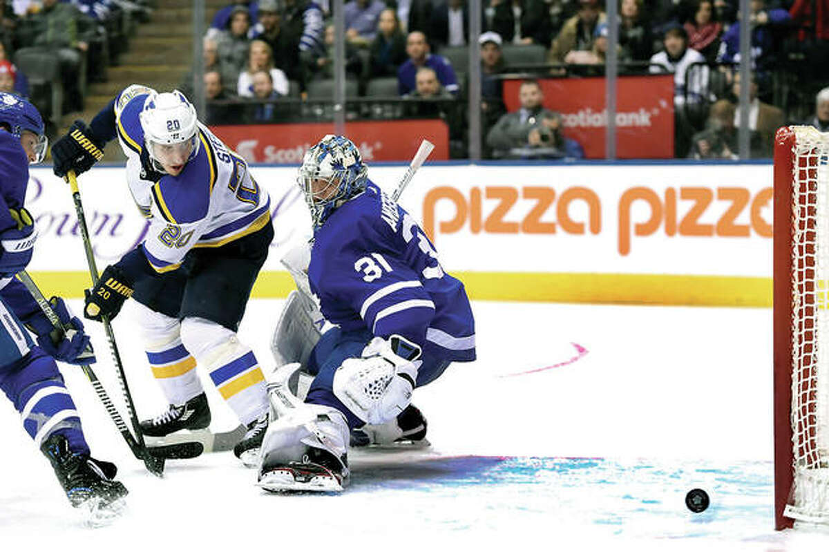 The Blues' Alexander Steen (20) scores against Toronto Maple Leafs goaltender Frederik Andersen in the third period of Tuesday night's game in Toronto. The Blues went on to win in overtime 2-1.