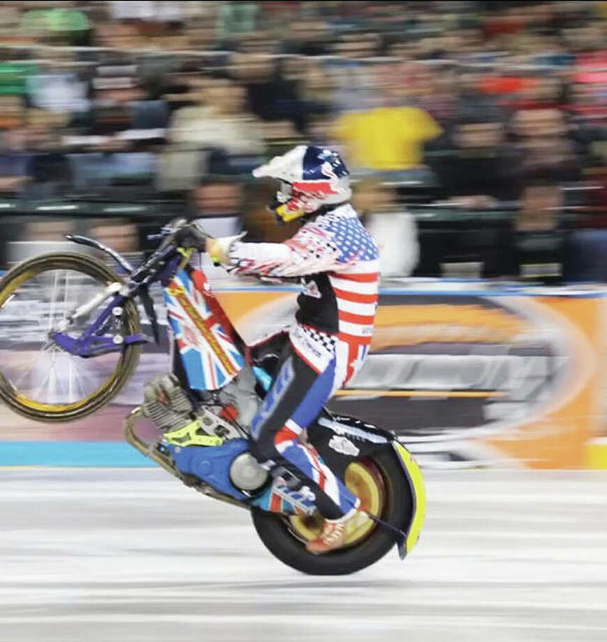 """The Xtreme International Ice Racing, or XIIR (pronounced """"X, Double I, R), is a professional motorcycle race held on ice, such as that utilized for a hockey game. Known as the world's toughest professional ice race, riders modify speedway bikes and quads to compete on an indoor ice arena. Photo: For The Telegraph"""