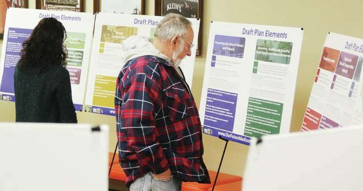 James Donahue, of Cottage Hills, right, and Christine Favilla, representing the Sierra Club, look over displays at an open house for Madison County's proposed comprehensive plan. Additional open houses were set for today and Wednesday Jan. 17 at the Collinsville City Hall, 125 S. Center St., Collinsville; and Tuesday, Jan. 23 at the Troy Village Hall, 116 E. Market St., Troy. The comprehensive plan serves as the county's official land use guide, and has not been updated since 2000.