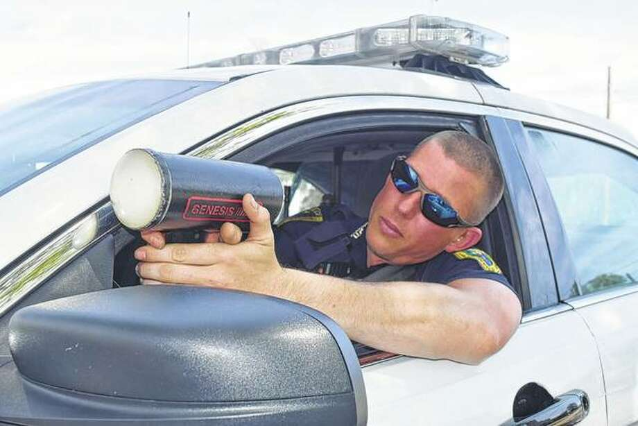 Jacksonville police Patrolman Joshua Radliff checks his radar Tuesday. Photo: Nick Draper | Journal-Courier