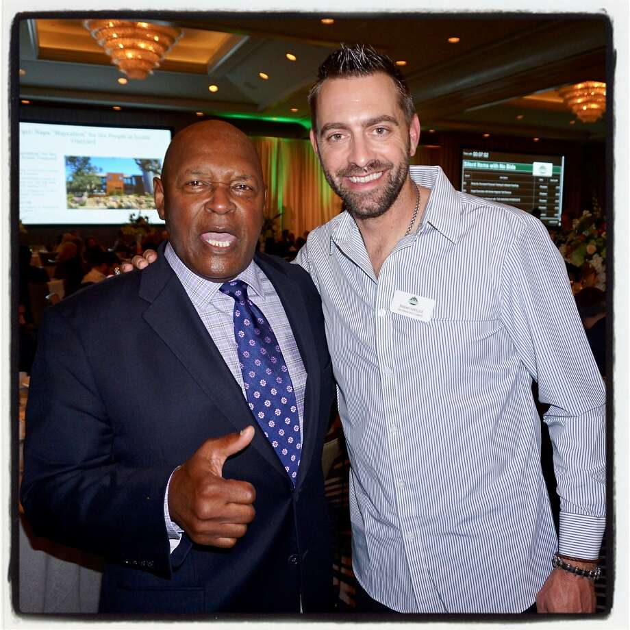 Former Giants greats Vida Blue (left) and Jeremy Affeldt at the dinner-auction at the Four Seasons. Photo: Catherine Bigelow, Special To The Chronicle