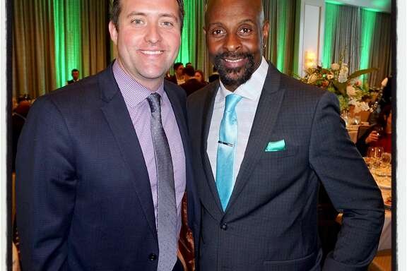 Guardsmen-SF Giants exec Joey Nevin (left) with 49ers great Jerry Rice at the Four Seasons Hotel. Feb. 8, 2018.