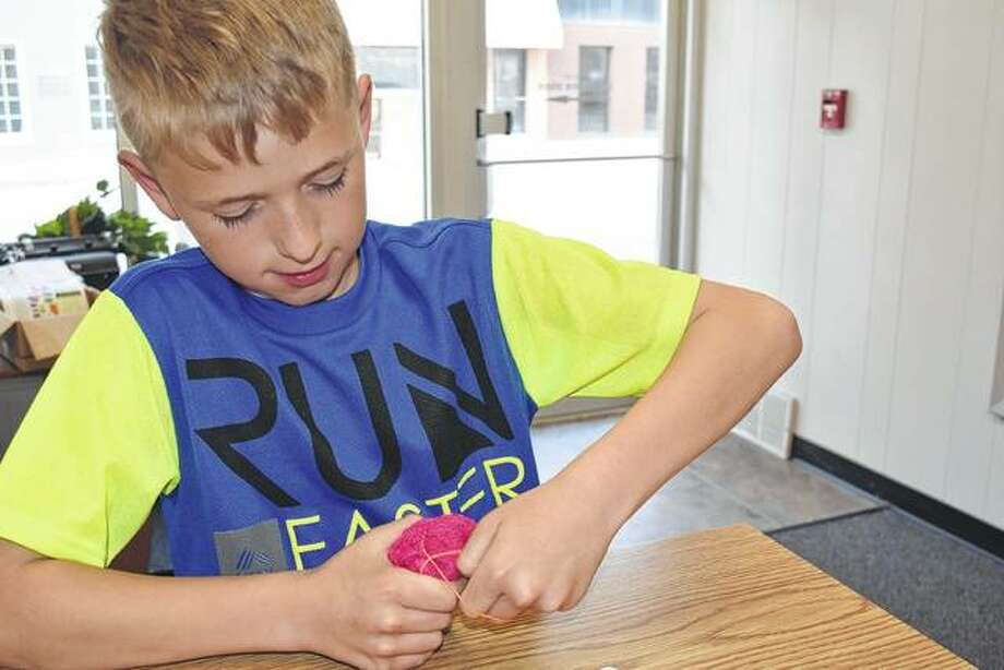 Jacob Kollman, a 10-year-old from Winchester, made bunnies out of wash cloths to raise money to send veterans on the Land of Lincoln Honor Flight. Photo: Samantha McDaniel-Ogletree | Journal-Courier